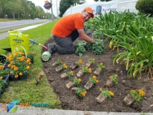Kyle putting in the beautiful annuals to spruce up a flowerbed