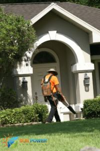 Andy uses Stihl Blower to keep sidewalk looking clean