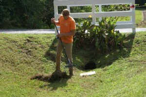 raking the lawn to improve lawn care